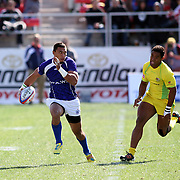Manu Samoa's Lio Lolo powers to a long gain but is stopped by Australia near the try lline during Day 2 of the USA Sevens Rugby at Sam Boyd Stadium, Las Vegas, Nevada, USA.  Photo by Barry Markowitz, 2/9/13.  Courtesy Samoa Tuna Processors/Tri