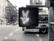 Upside down walk and don't walk electric signs on a corner on the upper east side of Manhattan