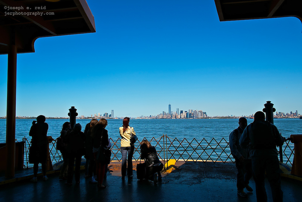People on lower deck of Staten Island Ferry looking toward Manhattan, New York, NY, US