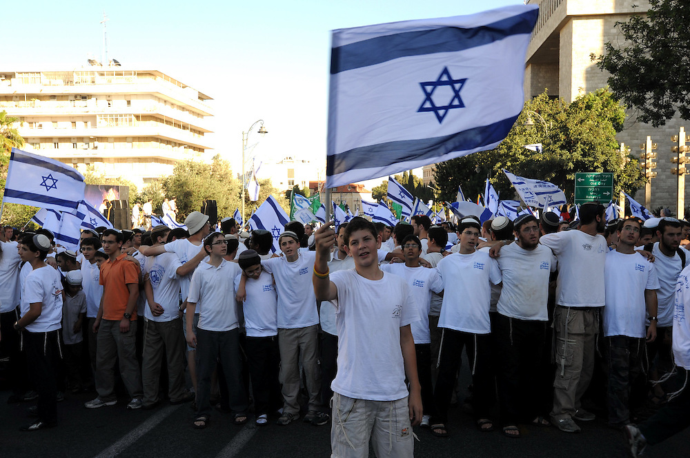 JERUSALEM, ISRAEL - MAY 12, 2010: Israeli youths wave Israeli flags during a march celebrating Jerusalem Day in the streets of Jerusalem, Thursday, May 12, 2010. Thousands of Israeli Jewish took part in Jerusalem Day celebrations in the capital, marked the 43nd anniversary of its capture of Arab east Jerusalem in the Six Day War of 1967..Photo by GILI YAARI - Israeli photographer, pictures of Israel, Israel photos