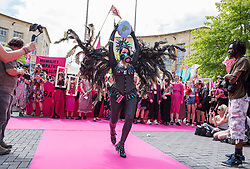 © Licensed to London News Pictures. 01/06/2019. Bristol, UK. Extinction Rebellion's catwalk fashion show in Bristol's Broadmead shopping centre. Campaigners from Extinction Rebellion are carrying out a five-hour protest which will include everything from a 'pop-up' catwalk to blocking the city centre traffic. The protest targets Bristol's fashion and clothes stores with people urged to not buy any new items of clothing for the next year. There will also be a 'pop-up catwalk', where designers will be showing off their work to demonstrate the needed shift away from fast fashion towards a fairer, safer, cleaner, more transparent fashion industry. People are encouraged to repair, re-use, alter, upcycle and recycle clothes in a year-long boycott aiming to economically disrupt the fashion and textile industry demanding that it drastically changes the way it currently exploits people and planet for profit. The protest is part of a series of disruptive activities planned by Extinction Rebellion to highlight the fashion industry's contribution to climate change, biodiversity loss and environmental pollution. Photo credit: Simon Chapman/LNP.