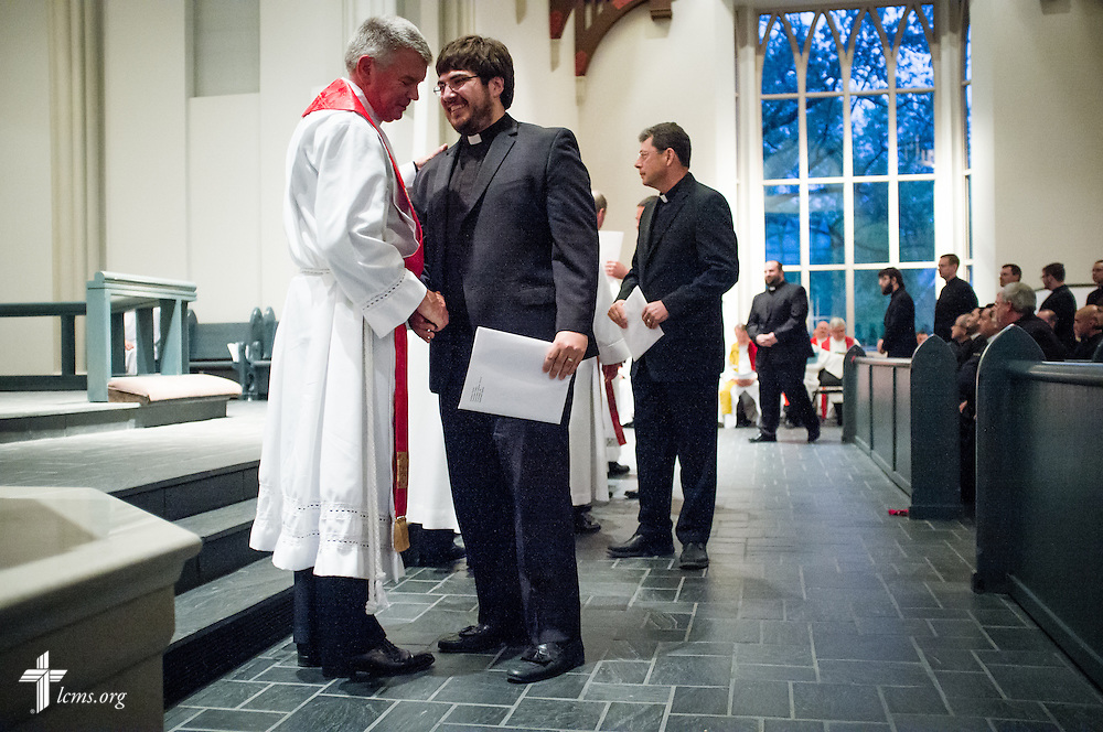 Candidates for ministry receive their calls during an evening worship Tuesday, April 29, 2014, during 'call day' in the Chapel of St. Timothy and St. Titus at Concordia Seminary, St. Louis.  Greeting the candidates is Concordia Seminary President Rev. Dr. Dale Meyer. LCMS Communications/Erik M. Lunsford