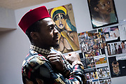 Model Akeem Pridgen strikes a pose fitting for the line of Black Panther inspired clothing he wears during a fitting at Jacqueline Addison's studio in Northeast Minneapolis.