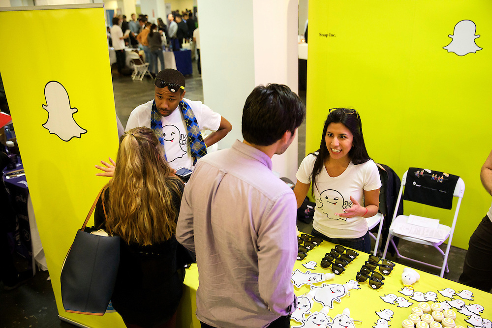 Job seekers speak with company representatives during the TechFair LA job fair in Los Angeles, California, U.S., on Thursday, January 26, 2017. Snap Inc., parent company of the Snapchat app has filed documents for an initial public offering (IPO) with the Securities and Exchange Commission (SEC). © 2017 Patrick T. Fallon