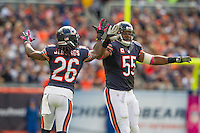 06 October 2013: Cornerback (26) Tim Jennings of the Chicago Bears celebrates with teammate (55) Lance Briggs after a Briggs tackle against the New Orleans Saints during the first half of the Saints 26-18 victory over the Bears in an NFL Game at Soldier Field in Chicago, IL.