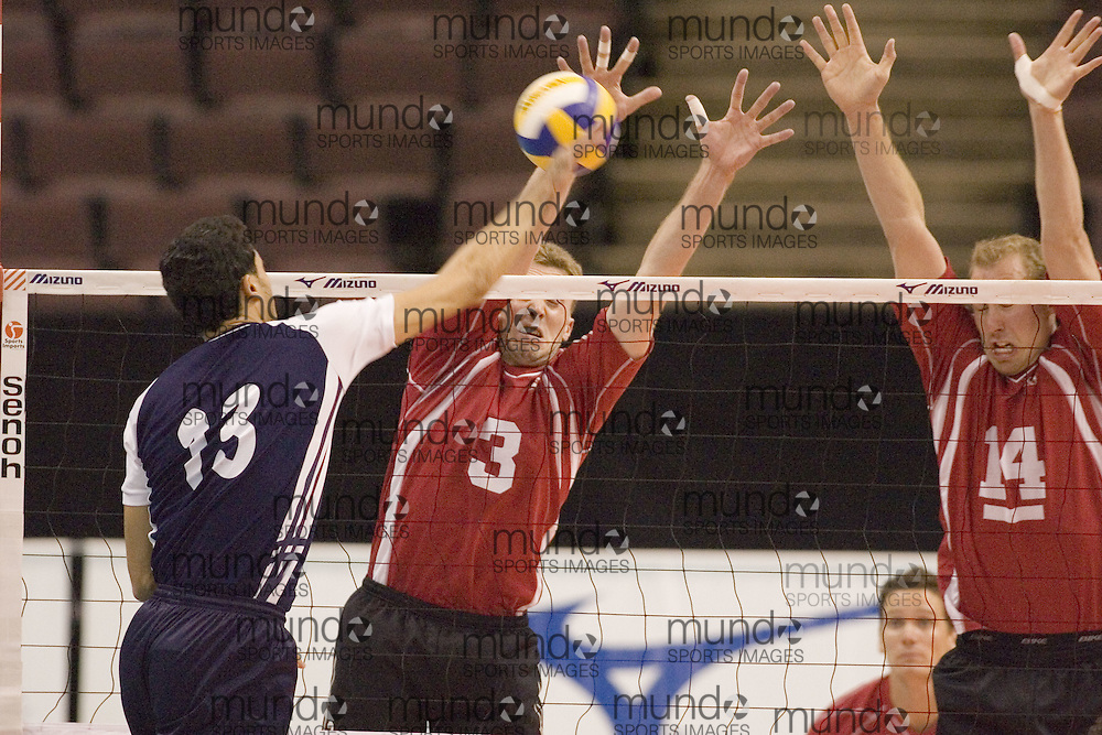 Michael Murray and Murray Grapentine blocking as Tunisia defeats Canada three games to two in the 2006 Anton Furlani Volleyball Cup. .Copyright Sean Burges / Mundo Sport Images, 2006 .Anton Furlani Cup.Copyright Sean Burges / Mundo Sport Images, 2006