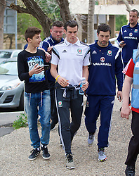 HAIFA, ISRAEL - Saturday, March 28, 2015: Wales' security steps in as a fan tried to get a selfie with Gareth Bale on a team walk ahead of the UEFA Euro 2016 qualifying Group B match against Israel. Head of fitness and science Ryland Morgans. (Pic by David Rawcliffe/Propaganda)