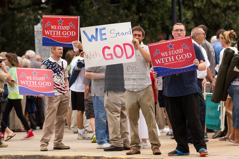"Evangelical Christians hold signs as they gather for the ""Stand With God"" rally  August 29, 2015 in Columbia, SC. Thousands of conservative christians gathered at the State House to rally against gay marriage and listen to GOP presidential candidates Gov. Rick Perry and Sen. Ted Cruz speak."
