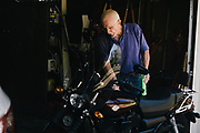 "HUNTSVILLE, AL – APRIL 5, 2016: Bill Thygerson prepares to clean his new XG500 Harley-Davidson motorcycle. Thygerson, 70, is one of thousands of elderly Americans eager to participate in a new anti-aging study targeting healthy adults. The trial, set to begin next in 2016, will test a theory the common diabetes drug metformin can extend life and prevent chronic diseases when taken by healthy people. As a former Vietnam vet who has always been active, Thygerson fears the long downward spiral associated with aging. ""It's not so much a fear of dying that bothers me,"" Thygerson said. ""It's a fear of living in pain and being a burden to everyone.""  CREDIT: Bob Miller for The Wall Street Journal<br /> LONGLIFE"