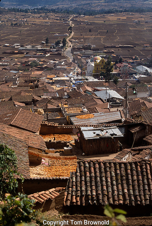 The corn harvest drying on the roof tops of a Guatemala village