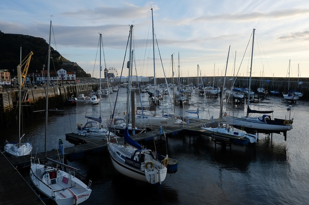 © Licensed to London News Pictures. <br /> 05/10/2014. <br /> <br /> Scarborough, United Kingdom<br /> <br /> Fishing boats and yachts are moored up in the harbour at Scarborough, North Yorkshire as dawn breaks over the north sea.<br /> <br /> Photo credit : Ian Forsyth/LNP