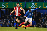 Portsmouth forward Oliver Hawkins (9) is fouled by Sunderland defender Glenn Loovens (4) resulting in a penalty during the EFL Sky Bet League 1 match between Portsmouth and Sunderland at Fratton Park, Portsmouth, England on 22 December 2018.