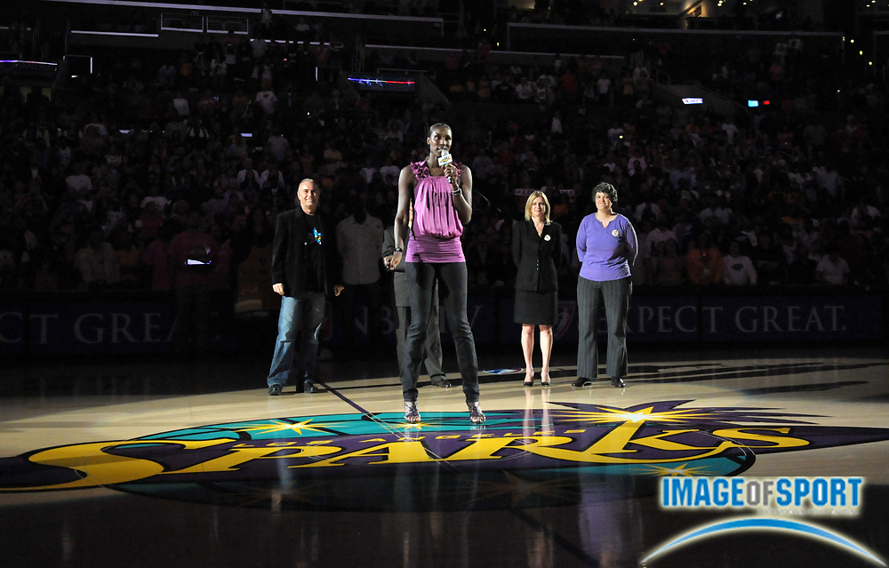 Aug 9, 2010; Los Angeles, CA, USA; Los Angeles Sparks former player Lisa Leslie (center) speaks at halftime ceremony to retire her No. 9 jersey during the game against the Indiana Fever as Johnny Buss (left) and Sparks co-owners Carla Christofferson and Kathy Goodman look on at the Staples Center. Photo by Image of Sport