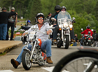 Steady flow of bike traffic in all shapes and sizes enter Weirs Beach on Sunday afternoon as Laconia's 93rd Motorcycle Week gets under way.   (Karen Bobotas/for the Laconia Daily Sun)