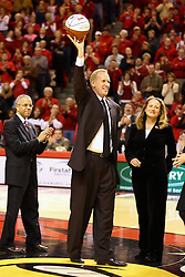 03 February 2007: With his wife at his side, Doug Collins accepts a ball from Illinois State University President Al Bowman during the pre-game ceremony naming the court in Redbird Arena Doug Collins Court.  Collins is regarded as the most prolific student athlete to ever attend Illinois State University. In what is locally referred to as the War on Seventy Four, the Bradley Braves defeated the Illinois State University Redbirds 70-62 on Doug Collins Court inside Redbird Arena in Normal Illinois.