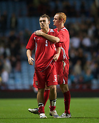 BIRMINGHAM, ENGLAND - Monday, October 13, 2008: Wales' Darcy Blake and Shaun MacDonald look dejected after losing to England during the UEFA European Under-21 Championship Play-Off 2nd Leg match at Villa Park. (Photo by Gareth Davies/Propaganda)