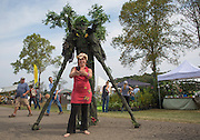 Erika Galentin takes a selfie with Cliff Spenger, the walking treeman, at the Pawpaw Festival on Sept. 17, 2016.