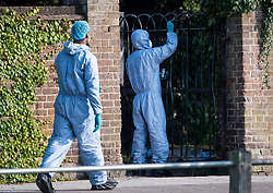 © Licensed to London News Pictures. 03/09/2018. London, UK. Police forensics dust for fingerprints at the scene of a shooting at Tottenham Cemetery, North London. Police were called to the cemetery at 07:53 this morning where they found a 22-year-old man suffering from gunshot wounds. He was pronounced dead at the scene. Photo credit: Ben Cawthra/LNP
