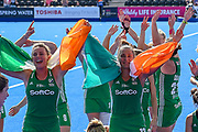 Nicola Evans of Ireland (8) (l) and Elena Tice of Ireland (12) celebrate winning their match with flags during the Vitality Hockey Women's World Cup 2018 Semi-Final match between Ireland and Spain at the Lee Valley Hockey and Tennis Centre, QE Olympic Park, United Kingdom on 4 August 2018. Picture by Martin Cole.