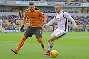 Wolverhampton Wanderers defender Matt Doherty (2) holds up Derby County striker Johnny Russell (7) 0-2  during the EFL Sky Bet Championship match between Wolverhampton Wanderers and Derby County at Molineux, Wolverhampton, England on 5 November 2016. Photo by Alan Franklin.