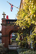 "Henley, Oxfordshire. England General View; ""The Red Lion""  The main entrance in Hart Street to the Hotel Building,  Union Flag flying over the entrance. Thursday  01/12/2016<br /> © Peter SPURRIER<br /> LEICA CAMERA AG  LEICA Q (Typ 116)  f1.7  1/800sec  35mm  9.3MB"