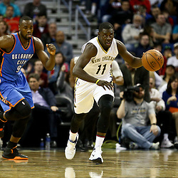 Feb 25, 2016; New Orleans, LA, USA; New Orleans Pelicans guard Jrue Holiday (11) drives past Oklahoma City Thunder forward Serge Ibaka (9) during the second half of a game at Smoothie King Center. The Pelicans defeated the Thunder 123-119. Mandatory Credit: Derick E. Hingle-USA TODAY Sports