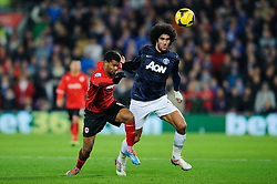 Cardiff Forward Fraizer Campbell (ENG) and Man Utd Midfielder Marouane Fellaini (BEL) compete for the ball during the second half of the match - Photo mandatory by-line: Rogan Thomson/JMP - Tel: Mobile: 07966 386802 - 24/11/2013 - SPORT - FOOTBALL - Cardiff City Stadium - Cardiff City v Manchester United - Barclays Premier League.