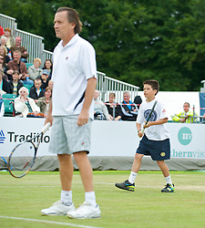 LIVERPOOL, ENGLAND - Sunday, June 21, 2009: A ball boy during Day Five of the Tradition ICAP Liverpool International Tennis Tournament 2009 at Calderstones Park. (Pic by David Rawcliffe/Propaganda)