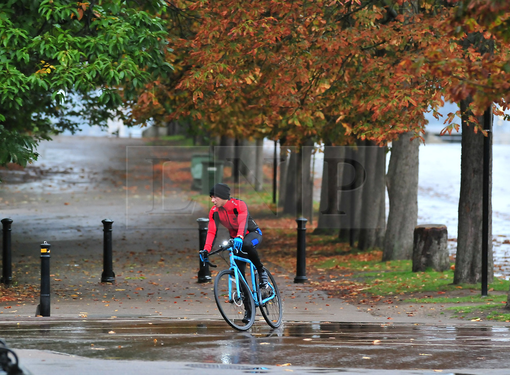 © Licensed to London News Pictures. 14/10/2018<br /> GREENWICH, UK.<br /> Wet weather morning in Greenwich Park, Greenwich as Storm Callum hits the UK.<br /> Photo credit: Grant Falvey/LNP