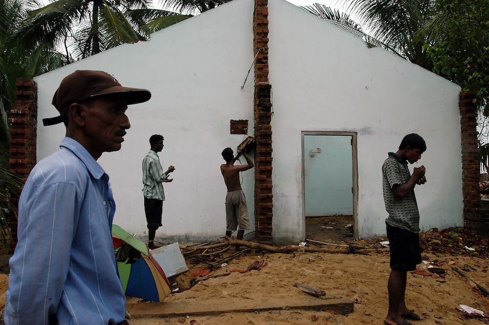 Victims of the December 26, 2004 Tsunami begin to return to their devastated homes from displaced person's camps to start the process of clearing away the debris and picking up the pieces of their lives..Batticaloa, Sri Lanka. 11/01/2005..Photo © J.B. Russell