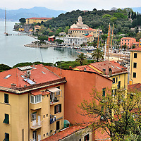 """Harbor View of Le Grazie, Italy <br /> Driving down a coastal road which winds along a peninsula in La Spezia Province is one of three towns that comprise Comune di Porto Venere: Le Grazie.  It does not draw as many tourists as other famous villages in Cinque Terre.  Nevertheless, it is charming, has wonderful beaches with calm waters plus a walking path called Codevalle.  It deserves at least a couple hours of exploration.  In Italian, """"grazie"""" means """"thank you"""" and that gratitude exudes from the local residents."""