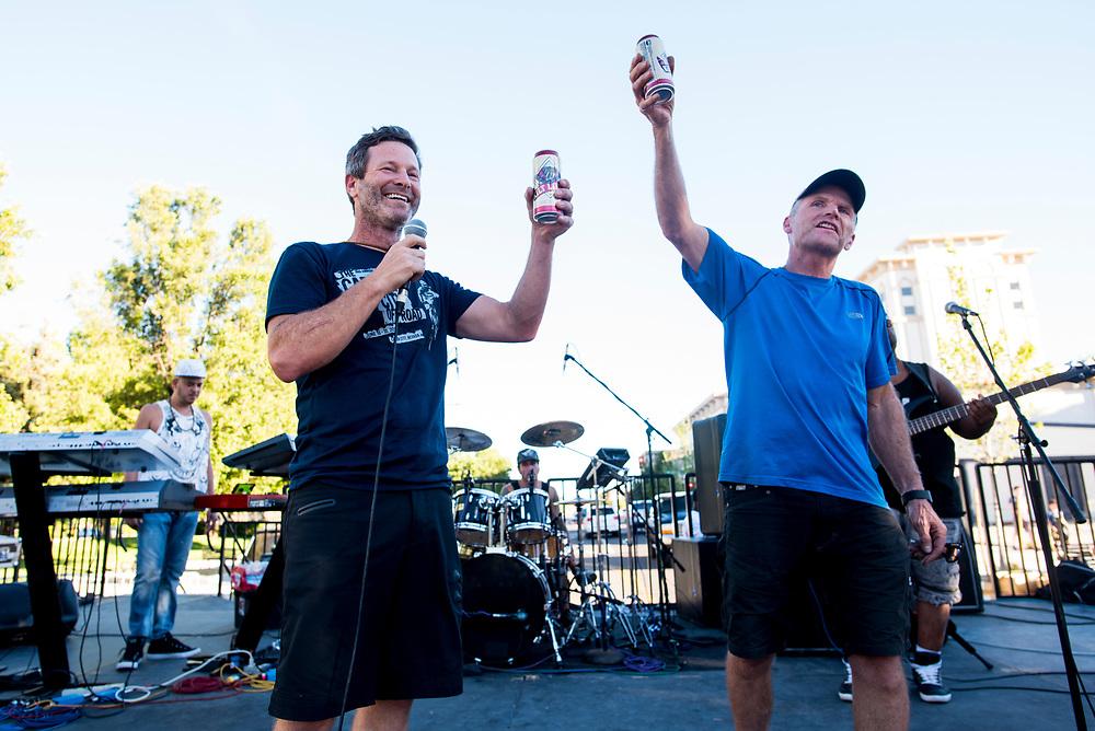 Epic Rides President Todd Sadow raises a pint to Mountain Bike Hall of Famer Max Jones on Saturday.