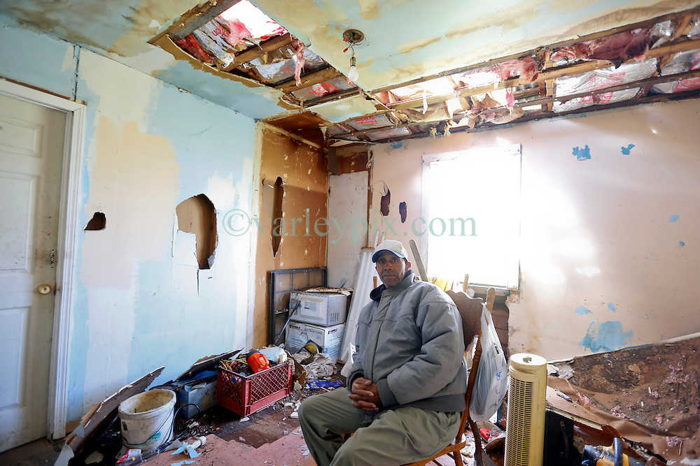 24 February 2016. Water tower Street, Convent, Louisiana.<br /> Devastation following a deadly EF2 tornado touchdown. 2 confirmed dead. <br /> Donald Green (62 yrs) sits in the remains of his home destroyed by the storm. Green was born and raised in the house left to him by his mother. He has no insurance. <br /> Photo©; Charlie Varley/varleypix.com