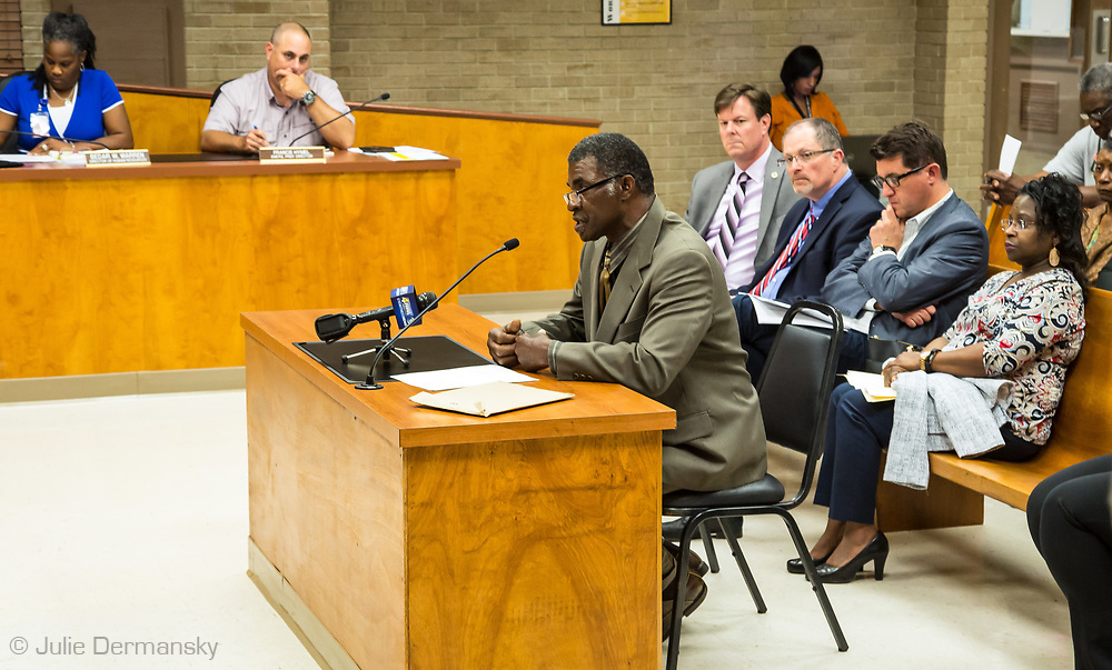 April 19 council meeting in St. James Parrish,  Rev. Joseph, St. James waits before his turn to speak.