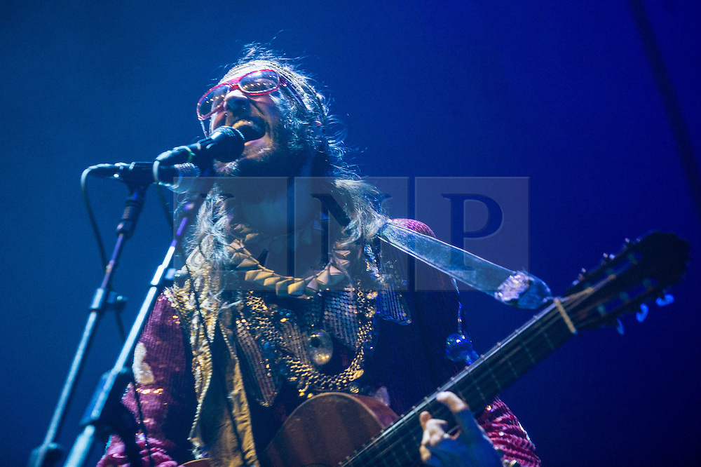 © Licensed to London News Pictures. 13/12/2013. London, UK.   Crystal Fighters performing live at The O2 Arena, supporting headliner Two Door Cinema Club. In this picture - Sebastian Pringle.  Crystal Fighters are a British alternative dance band composed of members Sebastian Pringle, Gilbert Vierich, Graham Dickson, Eleanor Fletcher.    Photo credit : Richard Isaac/LNP
