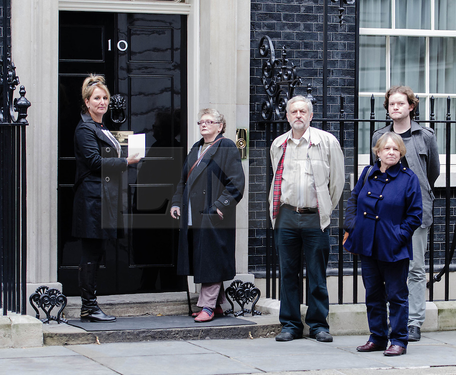 © Licensed to London News Pictures. 07/10/2012. London, UK. Caroline  Munday (1st from Left), Joan Humphreys (2nd from Left), Jeremy Corbyn (3rd from Left) and others deliver a letter to the Prime Minister at Number 10 Downing Street asking that he withdraw British troops from Afghanistan by the end of the year.   This followed a protest against the war in Afghanistan held at Trafalgar Square by the Stop the War Coalition. Those who attended included Caroline Munday (mother of Trooper James Munday who was killed serving in Afghanistan in 2008), Joan Humphreys (grandmother of Private Kevin Elliott of the Blackwatch regiment who was killed serving in Afghanistan in 2009) Jeremy Corbin MP, Paul Flynn MP, Kate Hudsen of CND, musician Brian Eno, and John Rees of Stop the War.  Photo credit : Richard Isaac/LNP