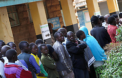Voters queue to enter a polling station in Nairobi, Kenya, March 4, 2013. A total of 14.3 million Kenyan voters lined up to cast their ballots Monday morning to choose the country s next president, the first after disputed presidential elections tally stirred up violence five years ago, Monday March 4, 2013. Photo by Imago / i-Images...UK ONLY