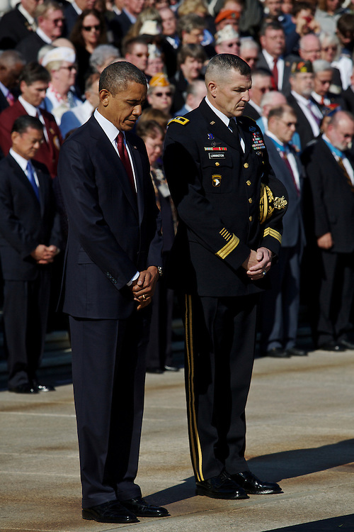 ARLINGTON, VA - NOVEMBER 11: U.S. President Barack Obama stands before the Tomb of the Unknowns with Maj. Gen. Michael Linnington during the Presidential Wreath-Laying Ceremony on Veteran's Day at Arlington National Cemetery on November 11, 2012 in Arlington, Virginia.