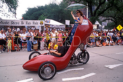 Stock photo of a man and woman riding in a stiletto car