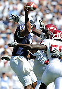 Sept 19, 2009; State College, PA, USA; Penn State quarterback Daryll Clark (17) manages to get off a pass down field dispute pressure form Temple linebacker Amara Kamara (56) during the first half at Beaver Stadium.  Mandatory Credit: Jason Miller-US PRESSWIRE