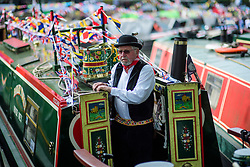 © Licensed to London News Pictures.30/04/2017.London, UK. A boat owner stands at the entrance to his narrowboat as the Canalway Cavalcade festival takes place in Little Venice, London on Saturday, 30 April 2017. Inland Waterways Association's annual gathering of canal boats brings around 130 decorated boats together in Little Venice's canals on May bank holiday weekend. Photo credit: Ben Cawthra/LNP