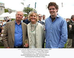 Left to right, SIR TERENCE & LADY CONRAN and her son TOBY, at a lunch in West Sussex on 27th June 2004.PWM 51