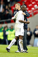 Photo: Richard Lane/Sportsbeat Images.<br />England v Croatia. UEFA European Championships Qualifying. 21/11/2007. <br />Englan's dejected Sol Campbell is consoled by Rio Ferdinand.