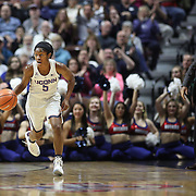 UNCASVILLE, CONNECTICUT- DECEMBER 4: Crystal Dangerfield #5 of the Connecticut Huskies in action watched by head coach Geno Auriemma during the UConn Huskies Vs Texas Longhorns, NCAA Women's Basketball game in the Jimmy V Classic on December 4th, 2016 at the Mohegan Sun Arena, Uncasville, Connecticut. (Photo by Tim Clayton/Corbis via Getty Images)