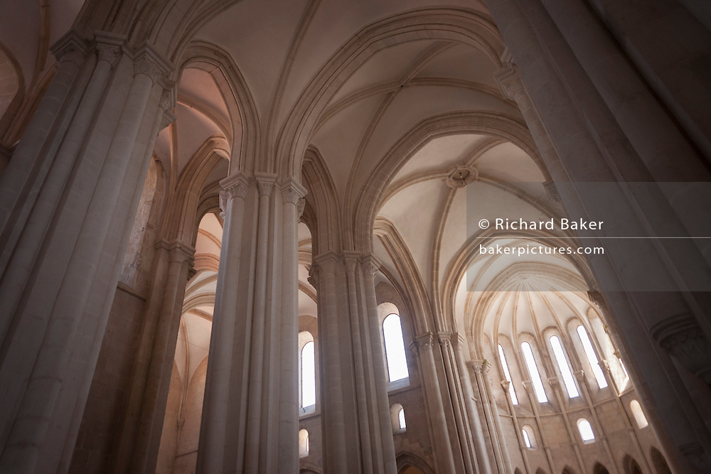 The vaulted roof and tall columns in the central nave of Alcobaca Monastery (Mosteiro de Santa Maria de Alcobaca), on 16th July, at Alcobaca, Portugal. The monastery was completed in 1223 for the Cistercian order and added to further by King Dinnis (Dennis) who built the main cloister and is now a UNESCO World Heritage Site. Austere architecture is in keeping with the Cistercian regard for simplicity. (Photo by Richard Baker / In Pictures via Getty Images)