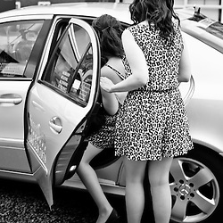 Manchester, UK - 4  August 2012: two  leopardskin dressed girls get into a cab getting ready for a night out.