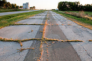 The original Route 66 is no longer used and is cracking with grass growing in the cracks. Missoula Photographer