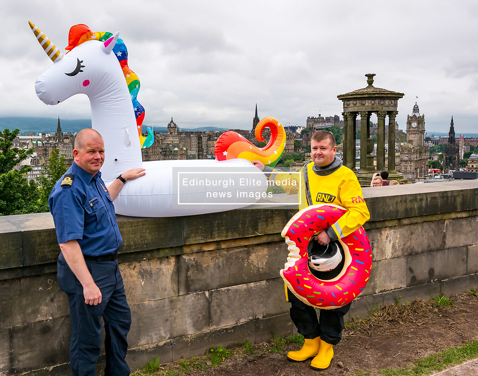 Pictured: Edinburgh Festival Fringe, Edinburgh, Scotland, United Kingdom, 01 August 2019 . RNLI and Coastguard crew members in uniform with a unicorn pool inflatable and swimming ring on Calton Hill in a campaign to discourage people from using them at beaches. There have been a number of incidents involving a variety of animal inflatables - especially recently during the hot weather - and thankfully no lives have been lost but some callouts have been very close calls. The advice is never to use these in the sea only in swimming pools. In the event of being blown out to sea, stay in the inflatable as it is easy for the rescue crew to see, no matter how far from shore. Pictured: L to R, RNLI lifeboat helmsman Scott McIlravie from Kinghorn station and Ross Greenhill, Coastguard Area Commander for the North Scotland (Perth to Unst).<br /> Sally Anderson | EdinburghElitemedia.co.uk