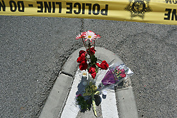 A makeshift memorial is shown at the perimeter of a police barricade on the Las Vegas Strip near the Route 91 Harvest concert venue Tuesday, Oct. 3, 2017, in Las Vegas. A mass shooting occurred late Sunday evening at the music festival. (Photo by Ronda Churchill/ZUMA Press)