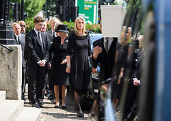 © Licensed to London News Pictures. 22/05/2018. London, UK. Family and friends watch The coffin arrive at the church for The funeral of television presenter Dale Winton at Commonwealth Church in Marylebone, London. Dale Winton, who was found dead at his home on April 18, was famous for presenting Supermarket Sweep and National Lottery game show. Photo credit: Ben Cawthra/LNP